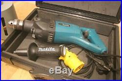 Makita 8406 diamond core drill 110v with a 117mm core bit